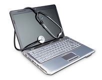 Stethoscope on a modern laptop to diagnose. Royalty Free Stock Images