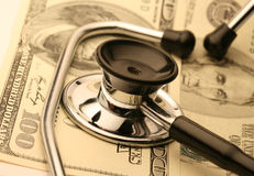 Stethoscope and money Royalty Free Stock Image