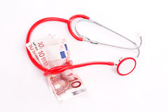 Stethoscope and money Royalty Free Stock Images