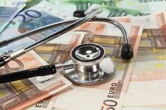 Stethoscope and Money Stock Photo