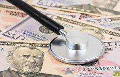 Stethoscope on money background Stock Image