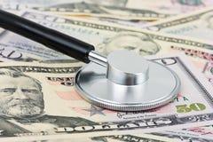 Stethoscope on money background Stock Image