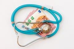 Stethoscope on money background. Expensive health treatment.  Stethoscope on money background Royalty Free Stock Photos