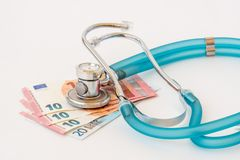 Stethoscope on money background. Expensive health treatment. Stethoscope on money background royalty free stock photos