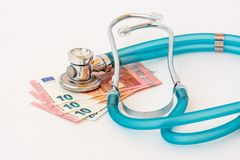Stethoscope on money background. Expensive health treatment. Stethoscope on money background stock image