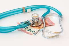 Stethoscope on money background. Expensive health treatment. Stethoscope on money background royalty free stock photography