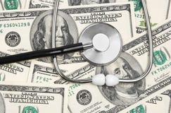 Stethoscope on money background Royalty Free Stock Images