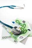 Stethoscope and money bills. On white background Stock Photo