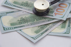 Stethoscope and money. Close-up Royalty Free Stock Photography