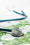 Stethoscope and money Royalty Free Stock Photography