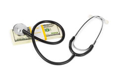 Stethoscope and money Royalty Free Stock Photos