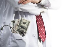 Stethoscope and money in medical doctor gown pocket royalty free stock image