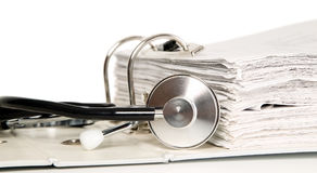 Stethoscope is near on papers Royalty Free Stock Photo