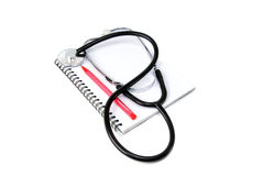 Stethoscope and notebook Stock Image