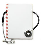 Stethoscope and notebook Royalty Free Stock Photo