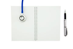 stethoscope and notebook with pen. Top view with c royalty free stock image