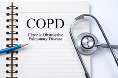 Stethoscope on notebook and pencil with COPD Chronic obstructiv. E pulmonary disease words as medical concept stock photography