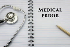 Stethoscope on notebook and pencil with medical error stock photos