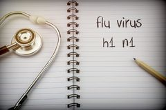 Stethoscope on notebook and pencil with flu virus h1 n1 words as. Conceptual image stock photography