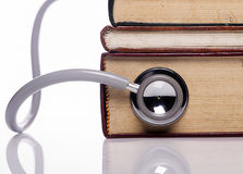 Stethoscope on old book stock image