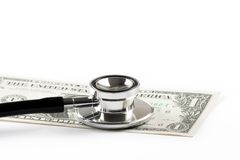 Stethoscope on one dollar, cost of medical health care Stock Photo