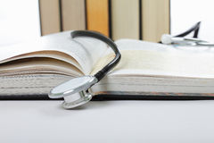 Stethoscope on open book Stock Image