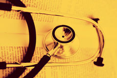 Stethoscope on a open book Royalty Free Stock Photography