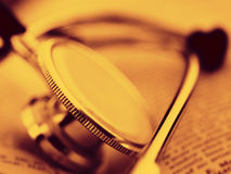 Stethoscope on a open book Royalty Free Stock Photos