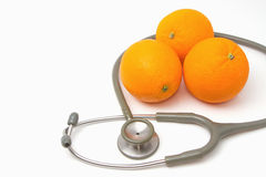 Stethoscope with orange fruit Royalty Free Stock Image