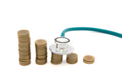 Stethoscope over coins. Concept of saving bad economy Stock Photos