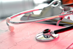 Stethoscope over EKG Graph in Medical Hospital Royalty Free Stock Image