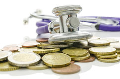Stethoscope over Euro coins Royalty Free Stock Photo
