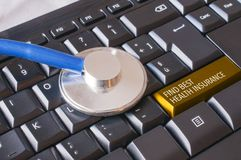 A stethoscope over a keyboard with a key that says: find best hea stock image