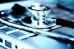 Stethoscope over laptop keyboard Royalty Free Stock Image