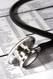 Stethoscope Over A Report Royalty Free Stock Image