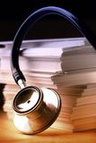 Stethoscope and paper cards Royalty Free Stock Photos