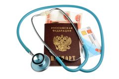 Stethoscope with passport, money and medical insurance policy is Stock Photos