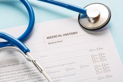 Stethoscope and patient medical history form. Health check diagnostics concept.  royalty free stock photography