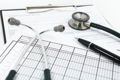 Stethoscope and pen on blank Patient information Royalty Free Stock Photo