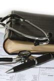 Stethoscope,  a pen and a blank prescription pad Stock Photos