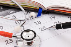 Stethoscope and pen. Doctor appointment. royalty free stock photo