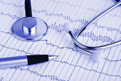 Stethoscope and pen on ecg Royalty Free Stock Photo