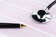 Stethoscope and pen on electrocardiogram. A stethoscope and pen on electrocardiogram printout Stock Image