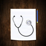 Stethoscope  with  pencil  on wood background Stock Images