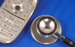 A stethoscope with a phone Royalty Free Stock Images