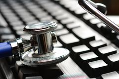 Stethoscope or phonendoscope on computer keyboard. Medical Information and technology concept, close up royalty free stock photo