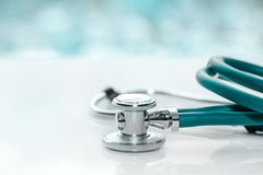 Stethoscope or phonendoscope on a doctor`s white desk on cloudy morning. Treatment of cold or flu. stock photography