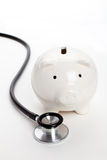 Stethoscope and Piggy Bank. Concept of Financial Health Royalty Free Stock Photography