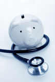 Stethoscope and Piggy Bank. Concept of Financial Health Stock Image
