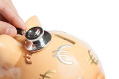 Stethoscope on a piggy bank, concept for save money. Stethoscope on a piggy bank on white background with space for text, concept for save money Stock Photos